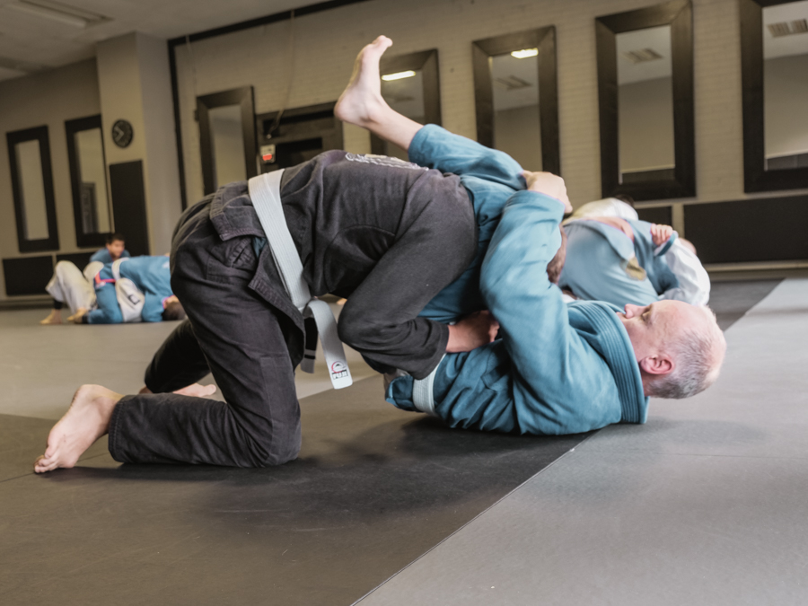 a student finishing a triangle submission
